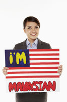 Businesswoman holding up an im malaysian