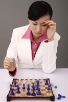 Businesswoman playing chessgame