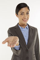 Businesswoman showing hand gesture