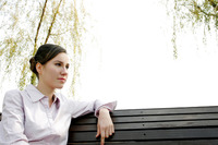 Businesswoman sitting on the bench thinking