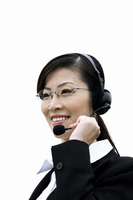 Businesswoman talking on the telephone headset
