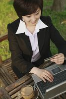 Businesswoman using laptop to shop online