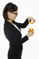 Businesswoman with a glass of orange juice
