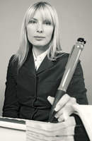 Businesswoman writing with a big pen
