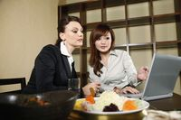 Businesswomen having discussion over lunch