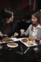 Businesswomen having lunch together