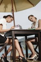 Businesswomen working by the poolside
