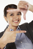 Cheerful businesswoman showing hand gesture