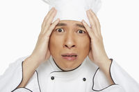 Chef touching his forehead
