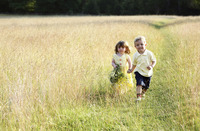 Children wandering in the meadow