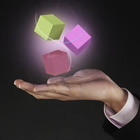 Colorful cubes floating above human hand