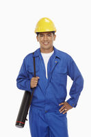 Construction worker holding a blueprint plan