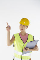 Construction worker pointing while holding a clip file