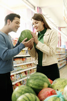 Couple choosing water-melon in the supermarket