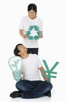 Couple holding up various cut out shapes