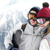 Couple in warm clothing and ski goggles