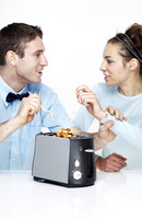 Couple making waffles with toaster