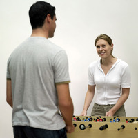 Couple playing foosball