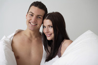 Couple posing with pillows