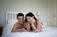 Couple reading message on cell phone