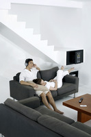 Couple resting in living room