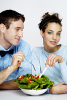 Couple sharing a bowl of salad