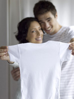 Couple showing a white onesie