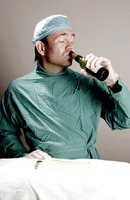 Doctor drinking alcohol in operation room