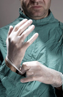 Doctor wearing surgical gloves
