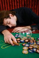 Drunk man lying on gaming table in casino