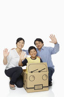 Family of three waving at the camera