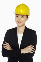 Female architect standing with arms crossed