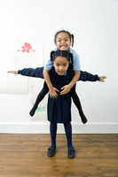 Girl carrying her sister on her back