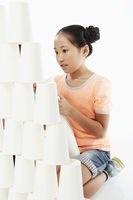 Girl stacking up disposable cups