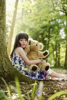 Girl with her teddy bear