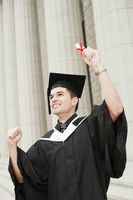 Graduate holding up his scroll
