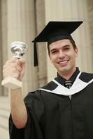 Graduate showing off his trophy