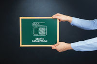 Popular : Hands holding blackboard with website optimization concept