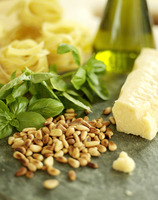 Ingredients for pesto sauce; pine nuts, basil, olive oil and tagliatelli