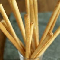 Italian sesame breadsticks in a glass