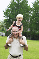 Little boy on father's shoulders