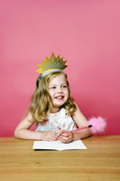 Little girl writing a greeting card