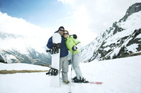 Male snowboarder and female skier