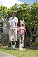 Man and girl with gardening tools