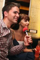 Man and woman at karaoke bar