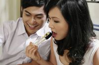 Man and woman eating sushi in a japanese restaurant