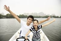 Man and woman having fun traveling on the boat