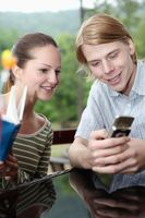 Man and woman reading text messages on mobile phone