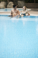 Man and woman relaxing in pool
