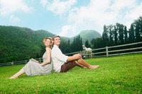 Man and woman sitting on grass
